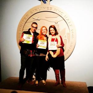 Juan, me and Flor getting our bibs with a giant medal